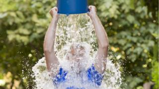 Pouring a bucket of cold water over his head