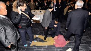 Kim Ki-Jong is restrained at the scene of the attack in Seoul (March 2015)
