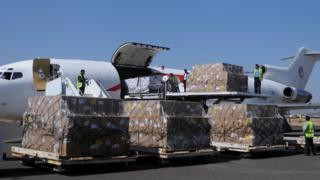 Workers unload aid shipment from a plane at the Sanaa airport, Yemen November 25, 2017