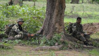 Central Reserve Police Force(CRPF) personnel mount a patrol outside the village of Kothaguda in Bijapur District on July 7, 2012,