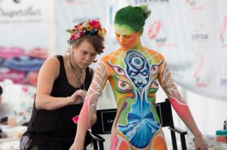 "An artist paints a model during the annual ""World Bodypainting Festival"" in Klagenfurt, Austria, 14 July 2018. The world""s biggest bodypainting event takes place from 12 to 14 July in Klagenfurt and celebrates its 20th anniversary this year."