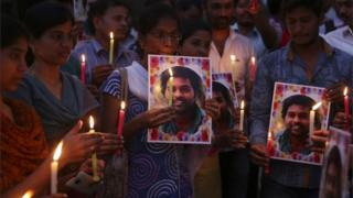 Activist of a Dalit organization participate in a candle light vigil holding photographs of Indian student Rohith Vemula in Hyderabad, India, Wednesday, Jan 20, 2016.