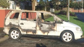 A burnt-out car in Ballymena