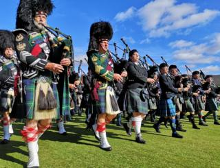 massed pipe and drums at the Braemar gathering