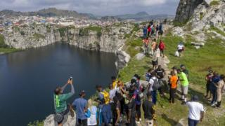 Tourists at Mpape Crushed Rock near Abuja, Nigeria