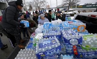 Bottled water being distributed in Flint
