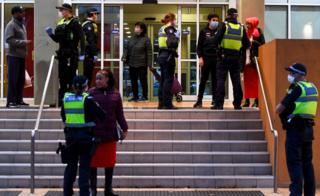 in_pictures Police officers speaking to residents outside the entrance to one of the housing tower blocks