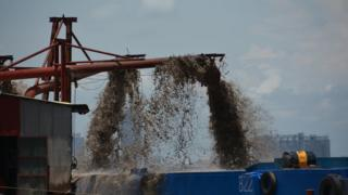 Removal of sand by a suction dredger from the bed of the Mekong River in Phnom Penh, Cambodia.