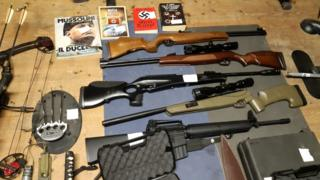 Weapons including automatic rifles that were seized in searches of properties of an extreme right group in Italy