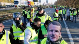 protester in Macron mask