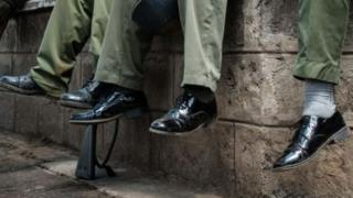 A picture of police officers in worn-out shoes