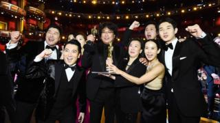 Best picture award winners Parasite pose with Oscar award