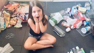 Ava Roberts with her family's plastic waste