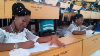 Dorcas Atsea and Deborah Atoh sit exam