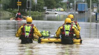 Fire rescue team with a dingy in a flooded road in July 2007