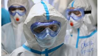 Medical specialists wearing personal protective equipment (PPE) in a Moscow hospital