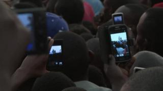 People using mobile phones in Uganda