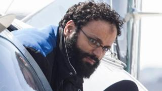Chiheb Esseghaier, one of two suspects accused of plotting with al-Qaida in Iran to derail a train in Canada, arrives at Buttonville Airport just north of Toronto, on 23 April 2013