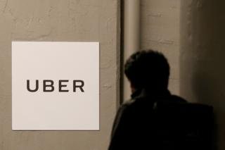 A man arrives at the Uber offices in Queens, New York, US, 2 February 2017