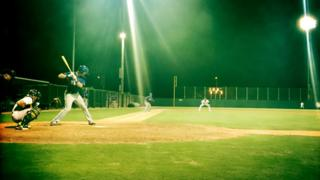 The Rangers are at bat against the A's in Mesa, Arizona.