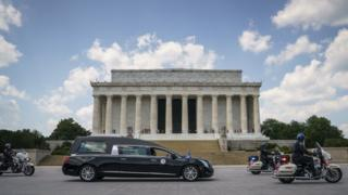in_pictures A hearse carrying the flag-draped casket with the body of Rep. John Lewis (D-GA) stops in front of the Lincoln Memorial before heading to the U.S. Capitol where he will lie in state July 27, 2020 in Washington, DC