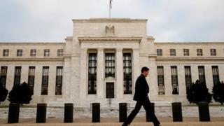 Man walks past US Federal Reserve