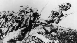British troops climbing from their trench on the first day of the Somme