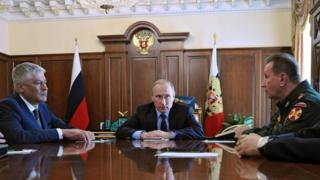 Vladimir Putin, with Viktor Zolotov to his left, announcing the new National Guard at a Kremlin meeting on 5 April 2016