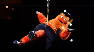 Gritty is lowered into Ice Hockey arena