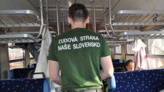 LSNS activist patrolling a train (source: party website)