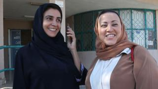 Saudi councillor for the Red Sea port of Jeddah, Lama Al-Sulayman (R) at a polling station