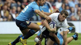 Scotland's centre Mark Bennett is tackled