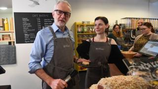 Jeremy Corbyn behind the counter of a coffee shop