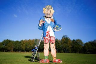 Artist Andrea Deans poses with the 11-metre effigy of Boris Johnson unveiled ahead of the Edenbridge Bonfire Celebrations in Edenbridge, Britain. 31 October 2018.
