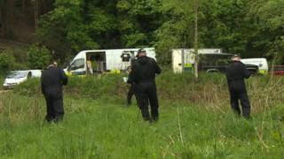 Police search grassland