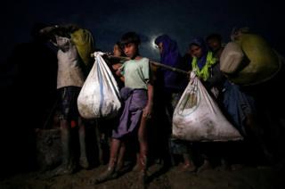 Rohingya Muslims continue their journey after crossing the Myanmar Bangladesh border at Palong Khali, Bangladesh, 1 November 2017.