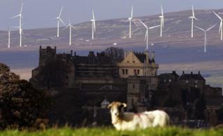 Stirling Castle, with the Braes of Doune wind farm in the background