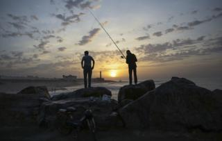 Fishermen wait for a catch on Rabat beach, Morocco, on Wednesday, Nov. 2, 2016. Rabat beach is a hub for families