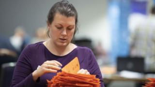 A woman counting votes
