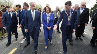 Mayor of Derry, John Boyle, steps over the Irish border with US Speaker Nancy Pelosi