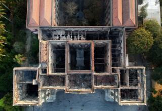 An aerial view of a museum gutted by a fire