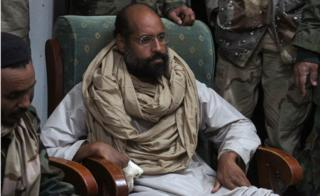 Saif al-Islam is seen after his capture, in the custody of revolutionary fighters in Obari, Libya November 19, 2011