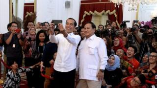 Joko Widodo and Prabowo Subianto pose for a selfie