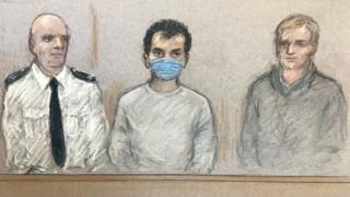 Court sketch of Khairi Saadallah (centre), appearing at Westminster Magistrates' Court on Monday by video link