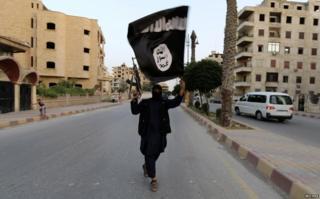 An IS loyalist in Raqqa, Syria, June 2014