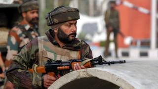 An Indian Army soldier takes position inside the 16 corps army headquarters after a militant attack in Nagrota, some 25km from Jammu, the winter capital of Kashmir, India, 29 November 2016
