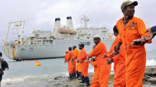 Workers haul a fibre-optic cable, which will serve East Africa, to shore at the Kenyan port town of Mombasa in 2009