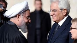 Iranian President Hassan Rouhani (left) is welcomed by Italian President Sergio Mattarella on January 25, 2016 upon his arrival at the Quirinale presidential palace in Rome