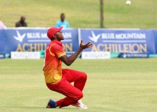 Zimbabwe fielder Carl Mumba takes a catch during the opening match of an ODI series Sri Lanka vs Zimbabwe in Harare, on November 14 2016.