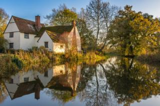 A cottage reflected in a river